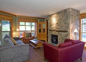 Legends Whistler suite living area with slopeside views.